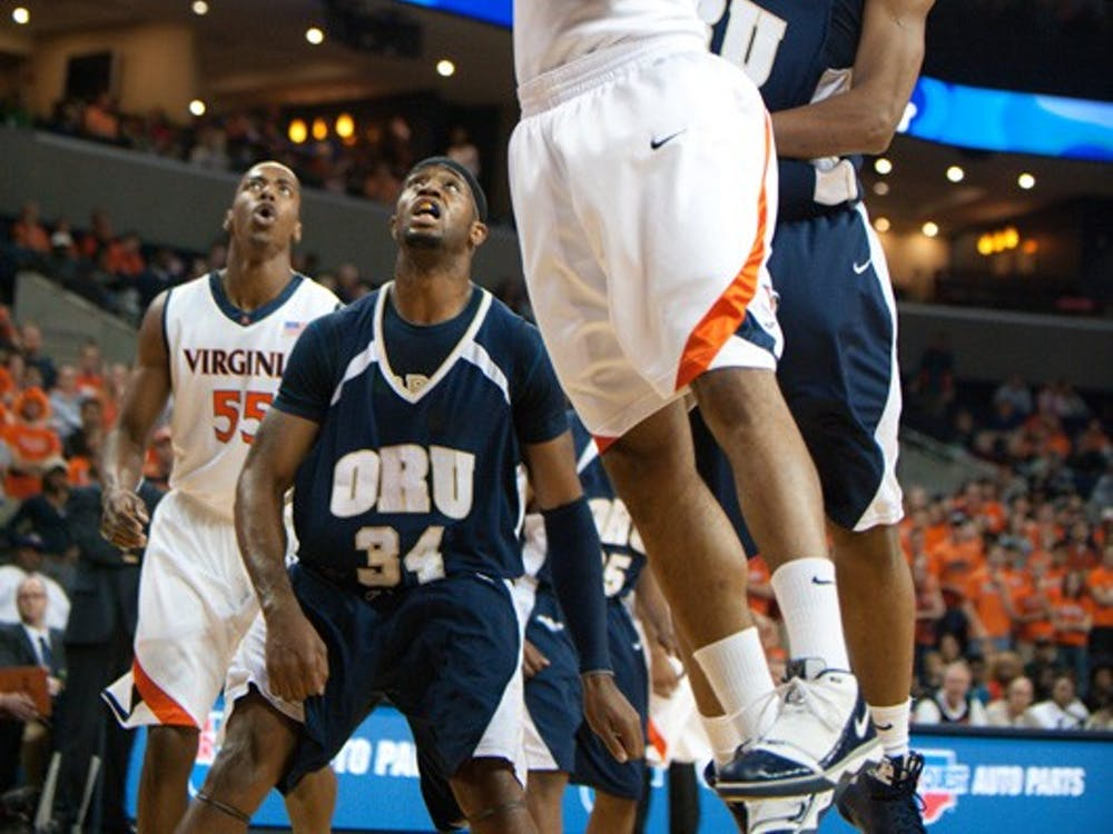 November 21; Charlottesville, VA USA; Virginia forward Mike Scott shoots against ORU. Virginia defeated Oral Roberts University 76-55.