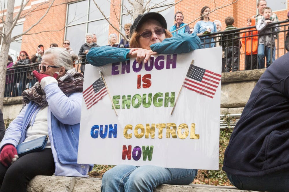 <p>More than a thousand people of all ages gathered at the Sprint Pavilion in Charlottesville before the march around the Downtown Mall, many holding signs against gun violence.</p>