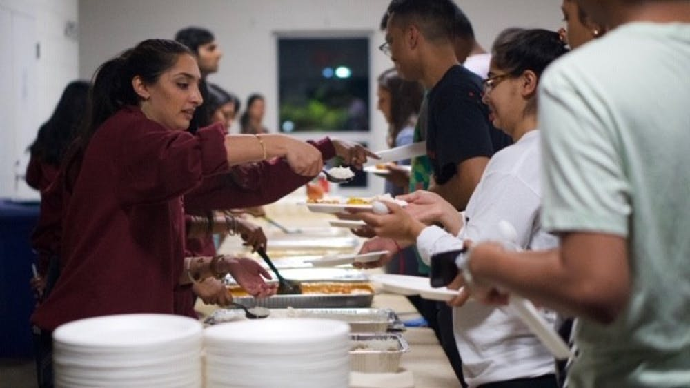 ISA members use eco-friendly materials to serve food at their second zero-waste event.