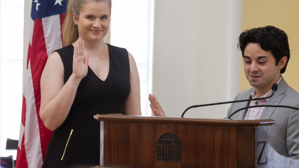 Ellie Brasacchio being sworn in by Student Council President Alex Cintron.