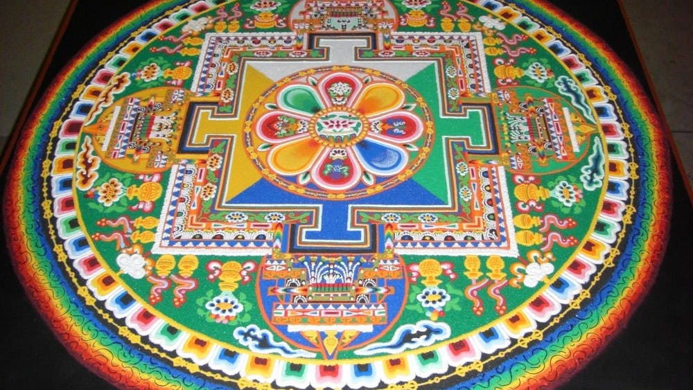 Leena Rose Miller, one of the organizers of the events in Charlottesville, said the community chose the mandala of the Buddha of Compassion for the monks to create.