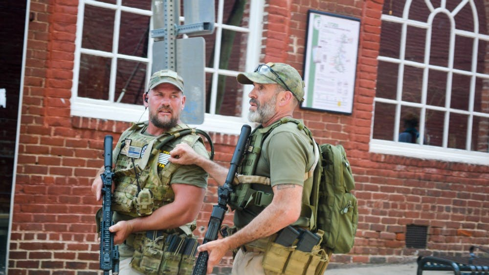 Several militia groups bared firearms in downtown Charlottesville during the Unite the Right rally of Aug. 12.