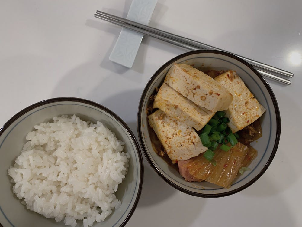 Each family has their own unique way of making this traditional Korean cuisine, but most renditions will at least include kimchi and tofu.