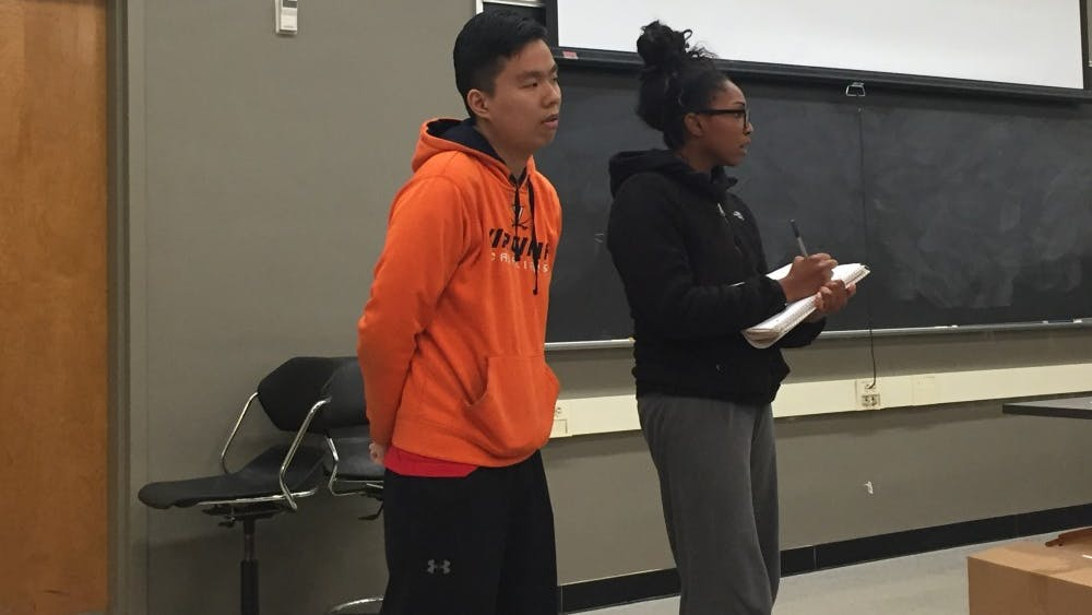 Eddie Lin, a third-year College student and Student Council representative (left), and Victoria Kasonde, a fourth-year College student and Legislative Affairs Committee co-chair (right), attended the College Republicans' meeting.