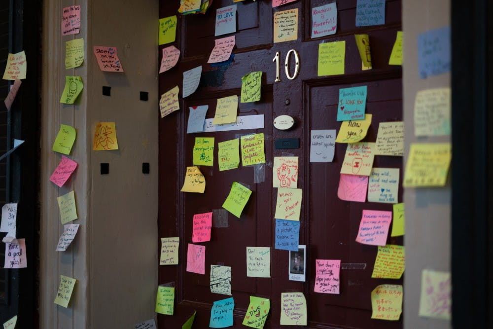 <p>Fourth-year Global Healthy Policy student Dan Xia's Lawn room door is decorated with sticky notes ranging from positive messages to light-hearted doodles.&nbsp;</p>