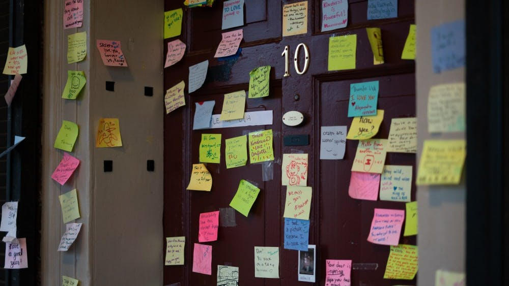 Fourth-year Global Healthy Policy student Dan Xia's Lawn room door is decorated with sticky notes ranging from positive messages to light-hearted doodles.