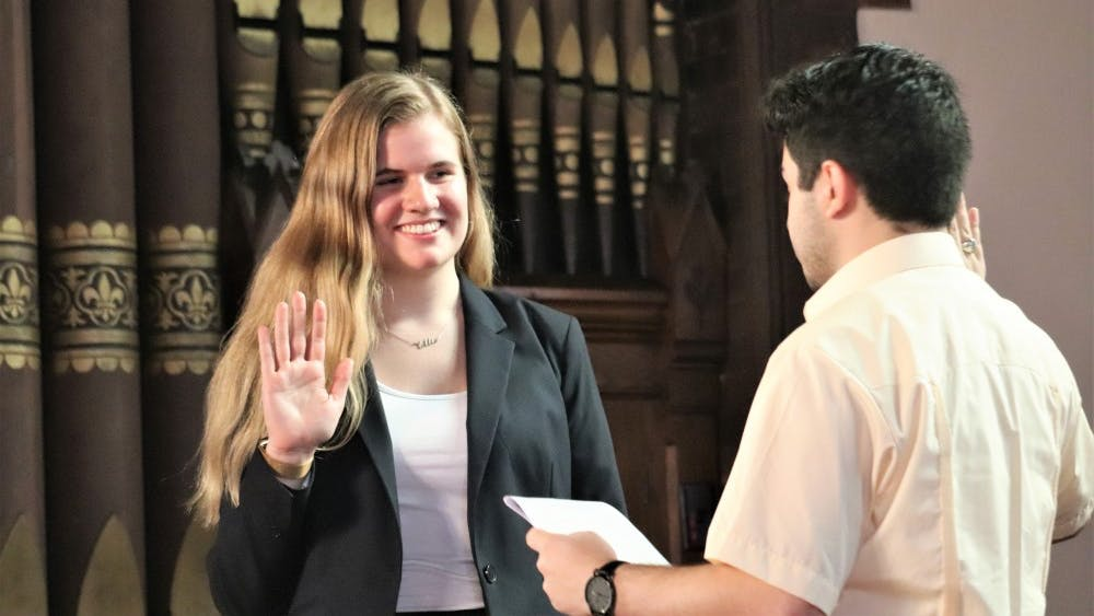 Brasacchio (left) was sworn in as Student Council president Sunday by Alex Cintron, a fourth-year College student and outgoing president.