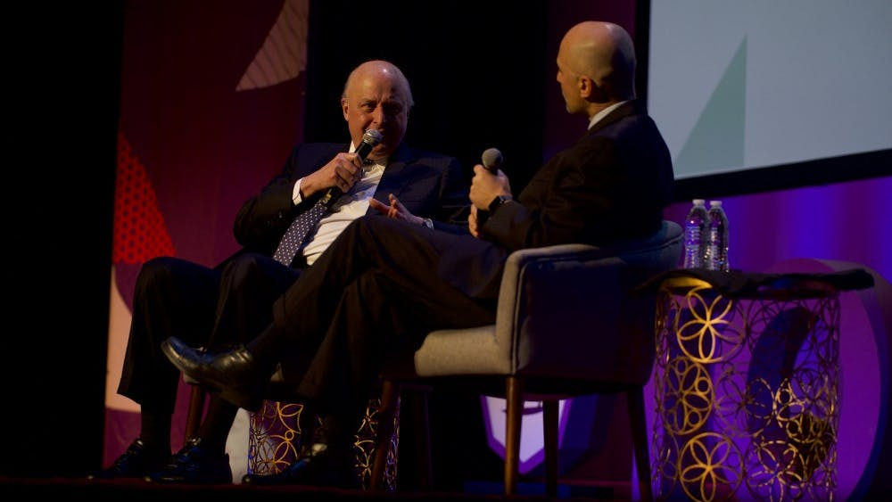 John Negroponte spoke at the TomTom Founder's Festival in April with Miller Center CEO William Antholis.