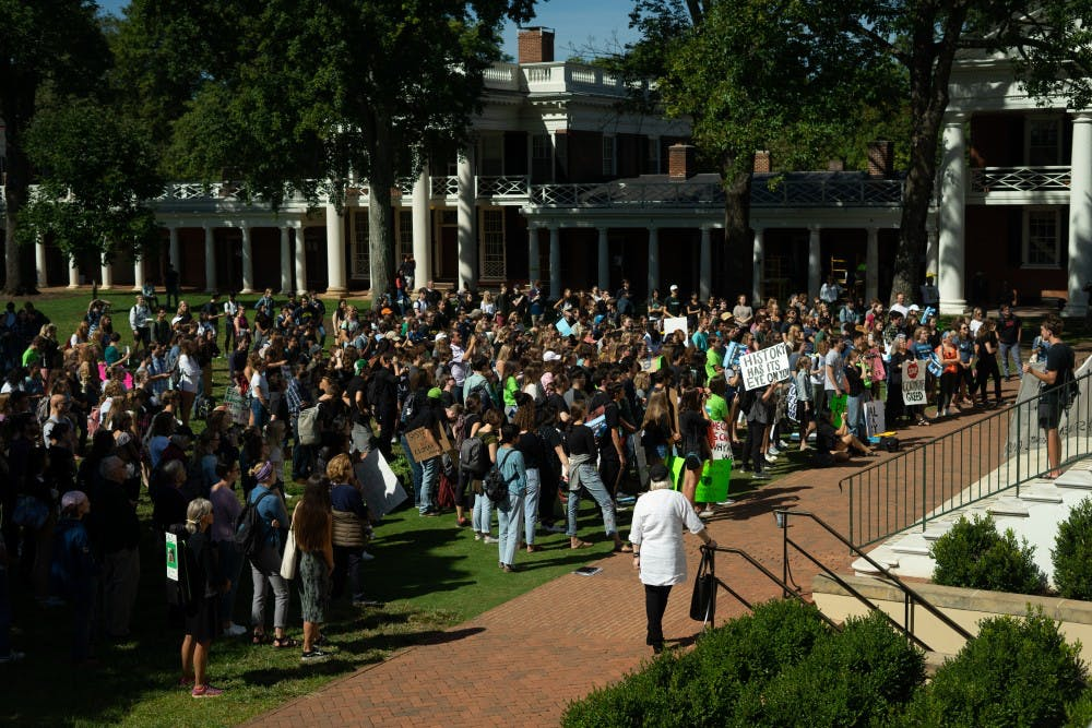 <p>Hundreds of students, faculty and community members gathered near the Rotunda Friday to join the Global Climate Strike movement.&nbsp;</p>