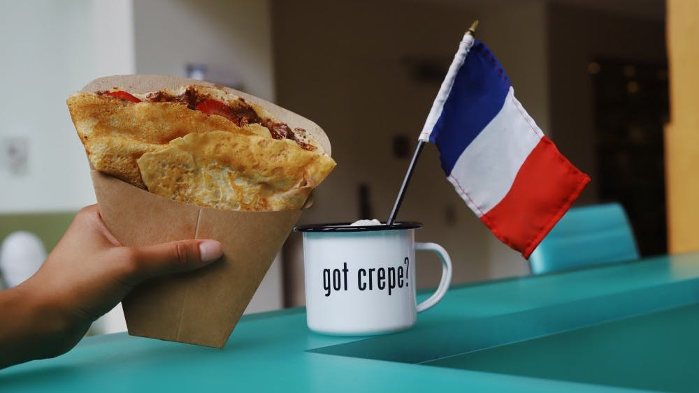 De Clippeleir holds her Nutella Strawberry crepe at the Crêpe Society's location in the iLab at Darden.