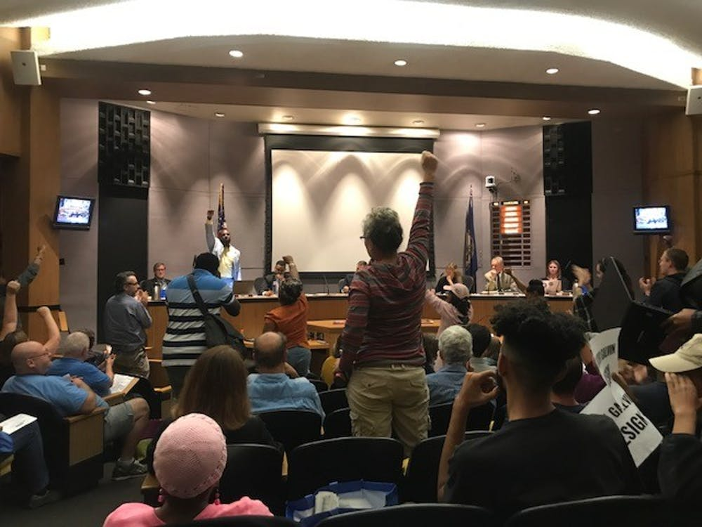 <p>Wes Bellamy stands before the City Council during a public hearing.</p>
