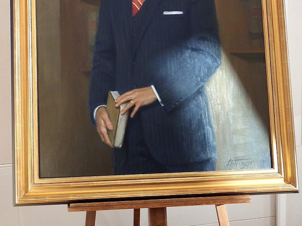 The portrait of Gregory Swanson features a plaque describing his successful lawsuit against the University for admission and his legacy as a the first African-American student and as an attorney.