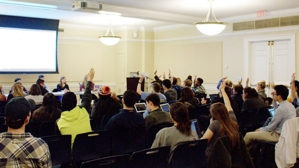 Members of student council voting at a meeting this spring — one of many forms of student self-governance on Grounds.