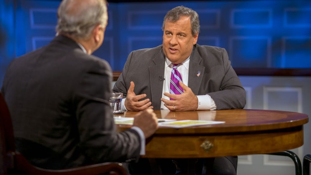 Host Doug Blackmon engages with former New Jersey Gov. Chris Christie during an American Forum earlier this February.