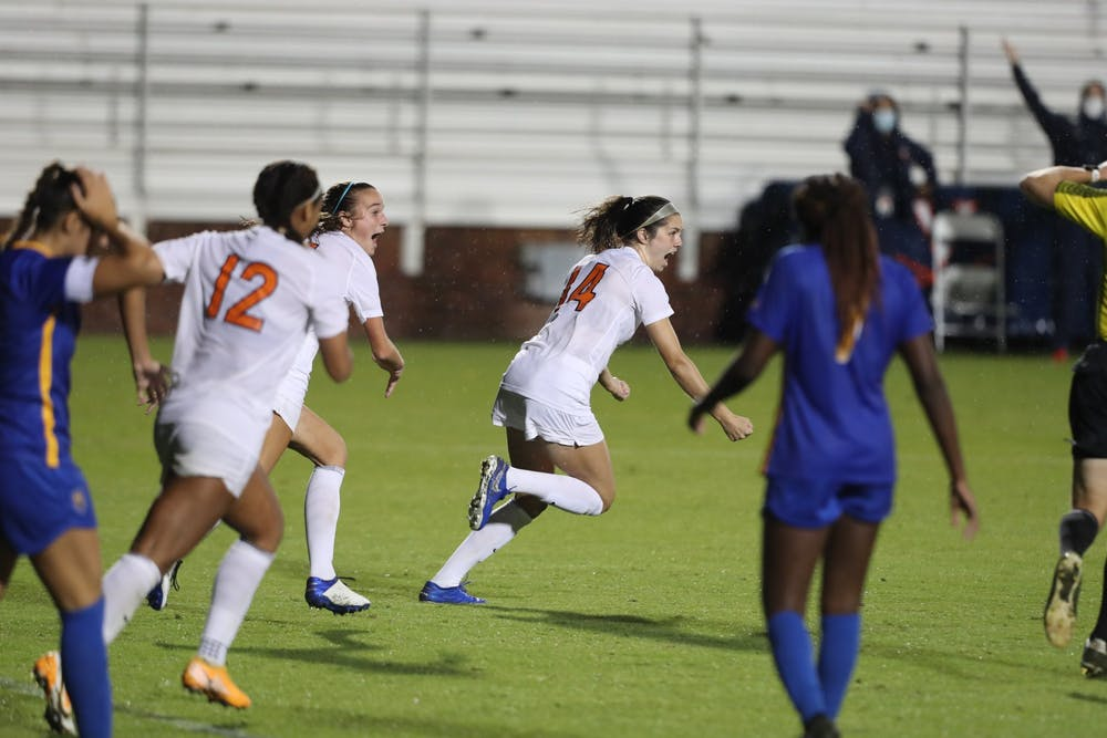 <p>Sophomore midfielder Emma Dawson celebrates her second collegiate goal to secure an overtime win against Pittsburgh Thursday night.&nbsp;</p>