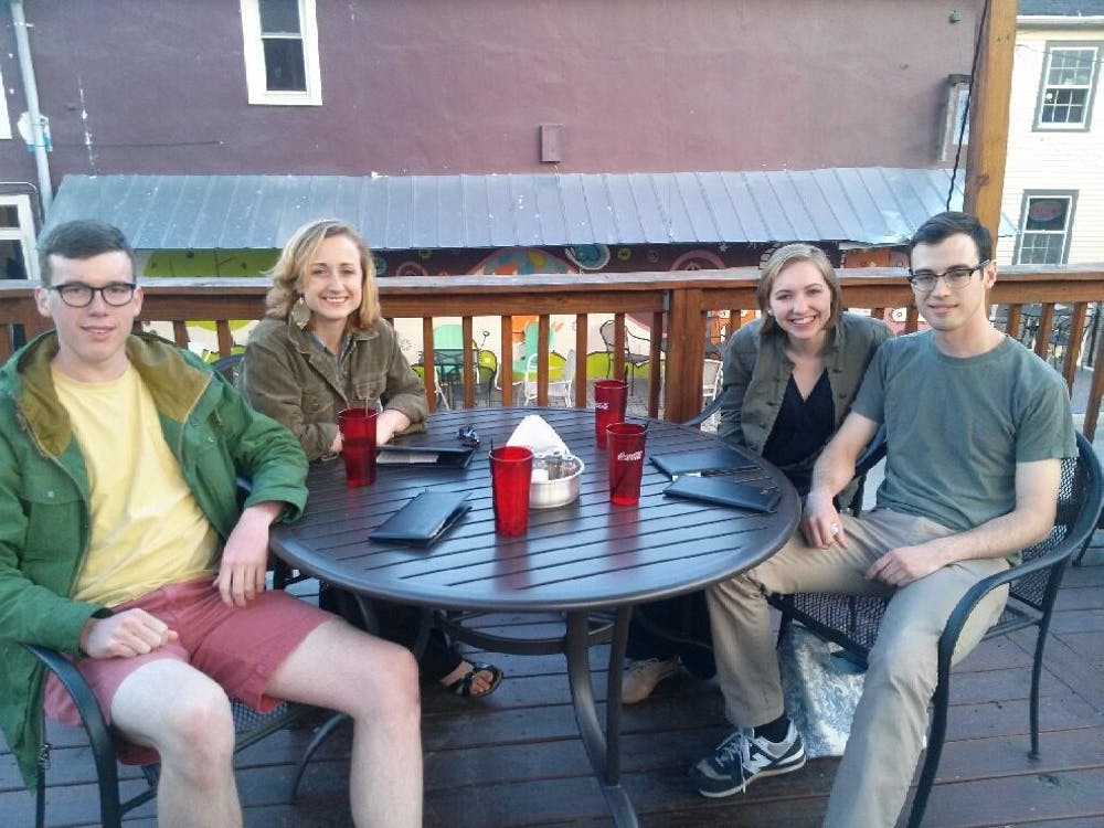 Second-year students Carly and Claire bond with third-year students Jimmy and Cory over shared interests and a chicken barbeque pizza.