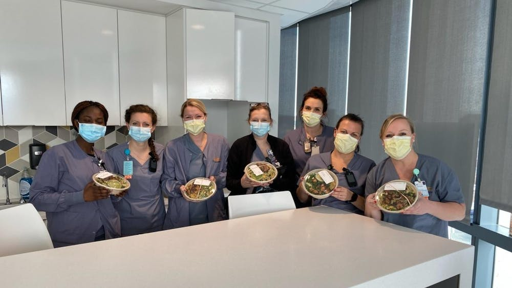 On Feb. 17, the four coordinated with friends and families to pool $1284.41 together and deliver 112 individually-wrapped Roots bowls, enough for every healthcare worker at the University Hospital's three COVID-19 units on that day's morning and night shifts.