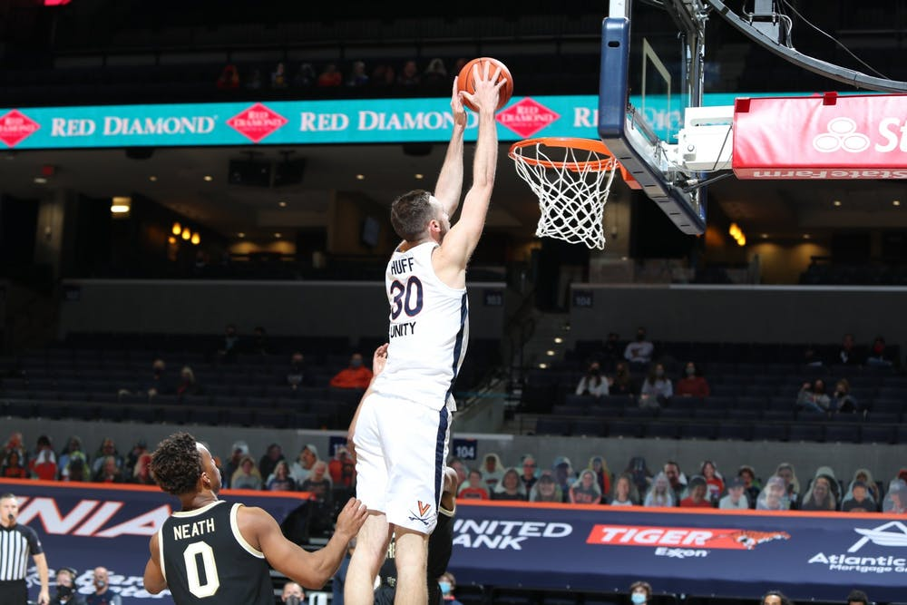 <p>Senior forward Jay Huff was one of five Cavaliers to post double-digit point tallies, scoring 11 Wednesday night.&nbsp;</p>