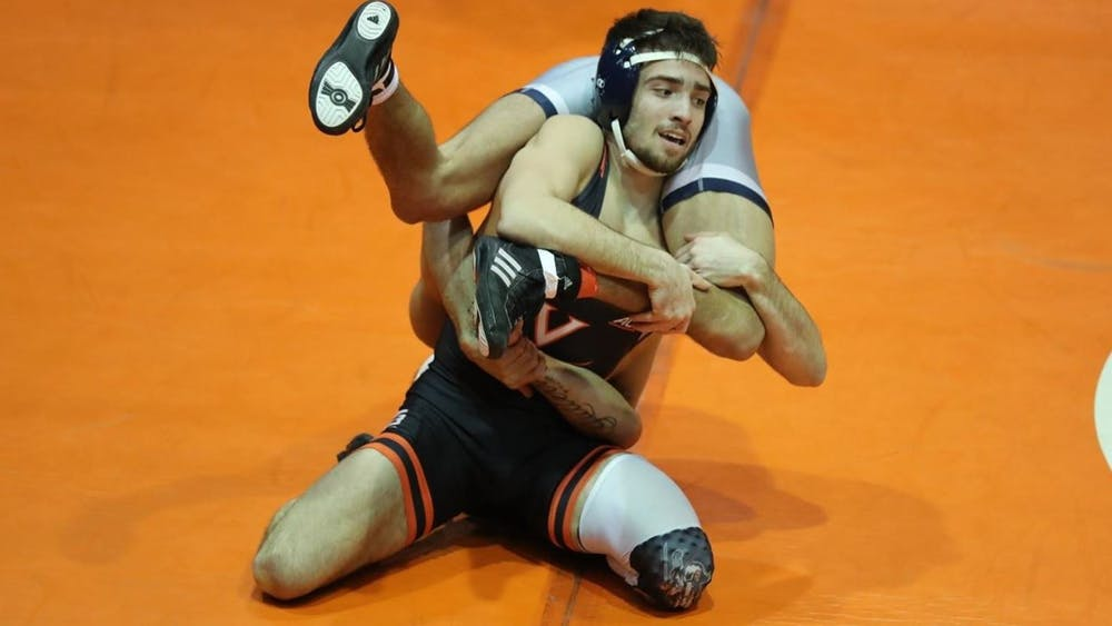 Virginia dominated Duke Friday night, winning its first five bouts with ease.