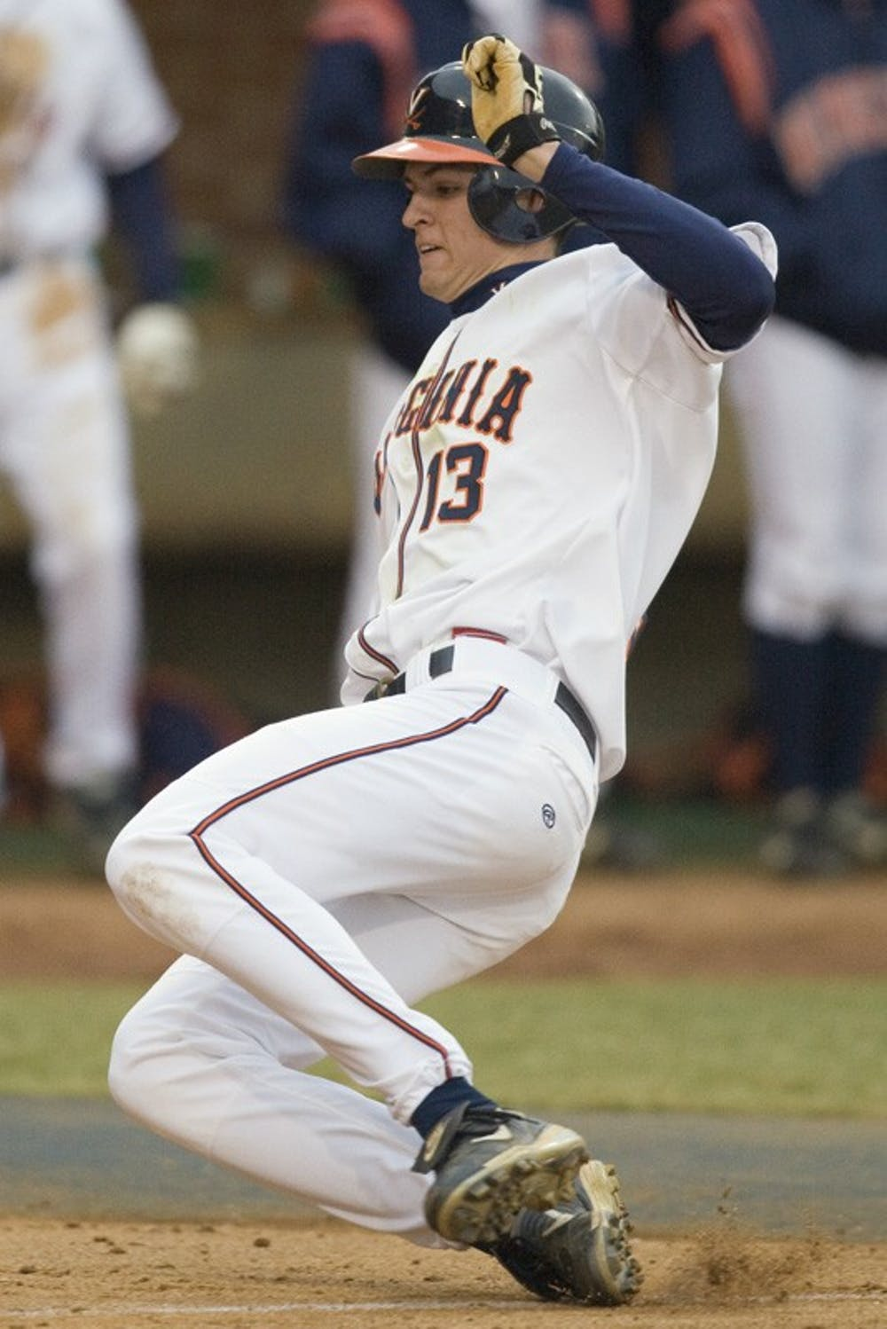 Virginia Cavaliers OF Jarrett Parker (13) slides in to home to score a run.  The #16 ranked Virginia Cavaliers baseball team defeated the Siena Saints 17-2 at the University of Virginia's Davenport Field in Charlottesville, VA on February 29, 2008.