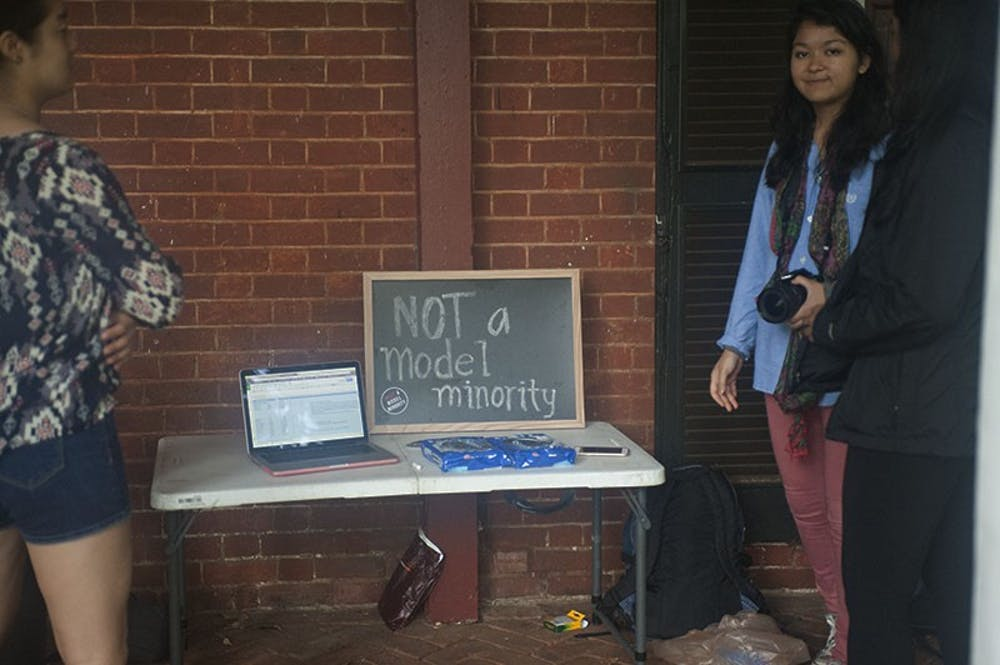 <p>Early in the week, students are able to gather on the lawn and stand with a chalkboard message sharing their personal stories dealing with the stereotype.</p>
