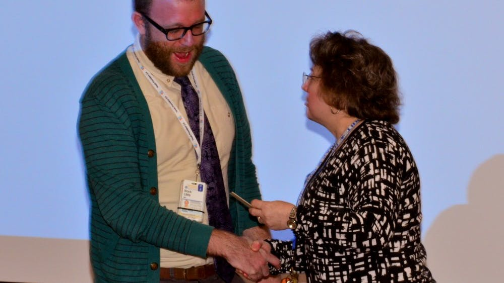 Pediatric resident Dr. Brock Libby receives the Nancy Walton Pugh Award for Child Advocacy for hiss work with LGBTQ youth programs.