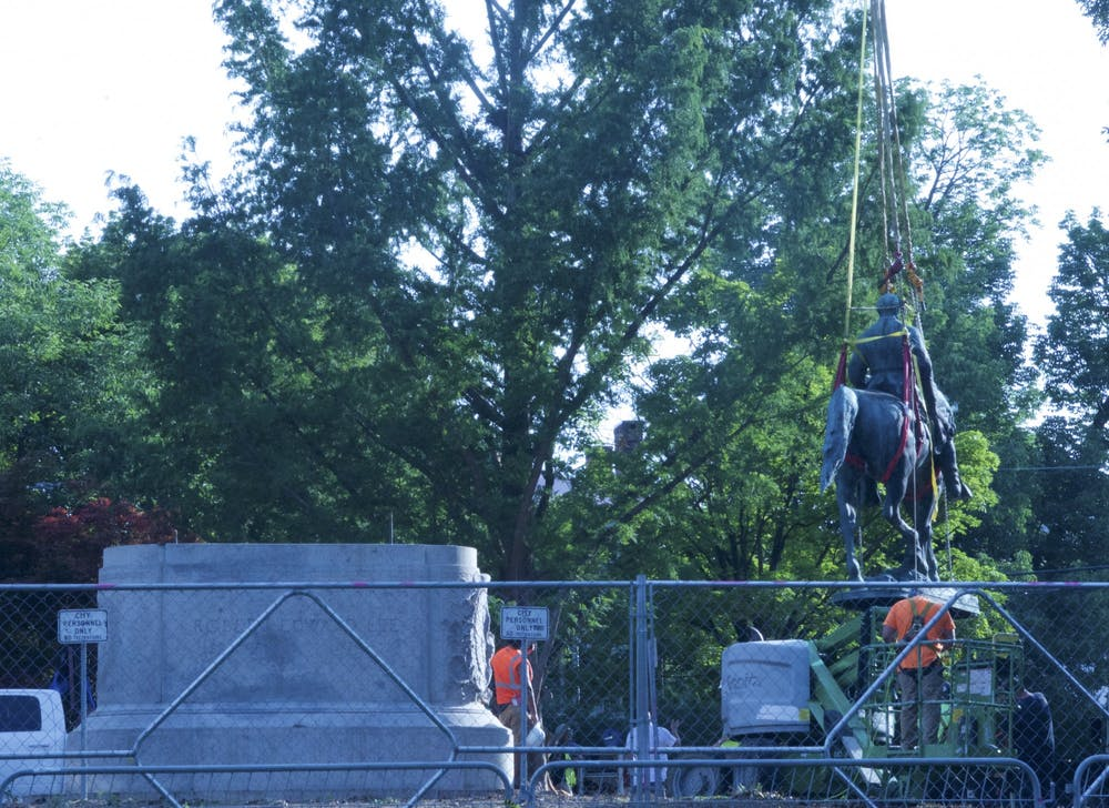 The statues will be placed in storage and their stone bases will be removed at a later date.