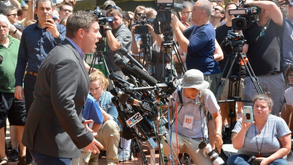 Jason Kessler attempting to speak at his press conference Aug. 13, before the event descended into chaos.