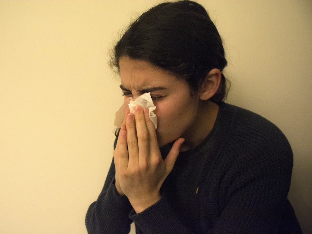 Spread by the influenza virus, the flu is a contagious respiratory illness associated with symptoms such as fever, cough, runny nose, vomiting and headaches.