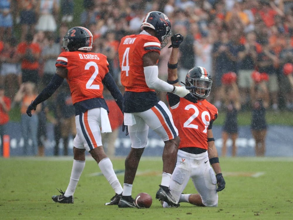 The Cavaliers celebrate after forcing a stop on defense against Duke Saturday afternoon.