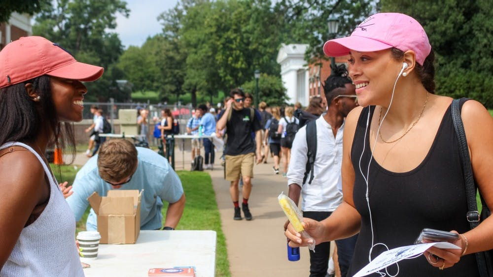 The Fourth Year Trustees Giving Campaign committee was stationed on the Lawn Thursday afternoon encouraging students to take two popsicles — one for themselves and another to gift to someone.