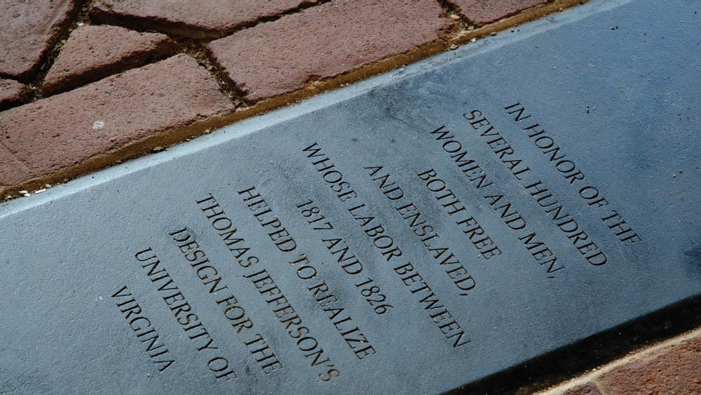 A plaque commemorating the several hundred enslaved laborers who helped to build the University.