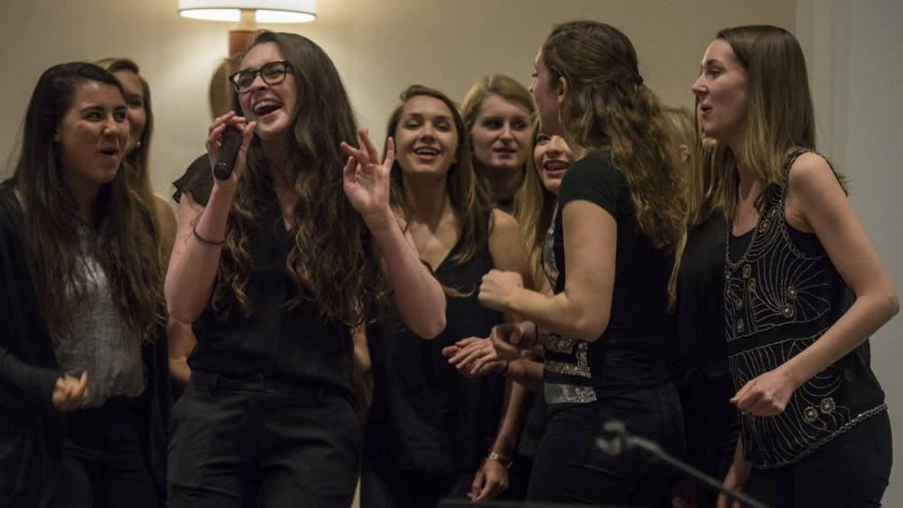 A cappella groups perform at the first event held byRefugee Outreach.