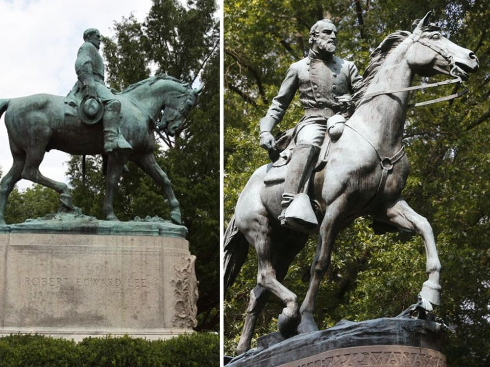 """The Lee (left) and Jackson (right) statues served as rallying points during the """"Unite the Right"""" rally in August 2017, when """"alt-right"""" groups and white supremacists marched down the Lawn with torches and held a violent rally in downtown Charlottesville, resulting in three deaths and 19 injuries."""