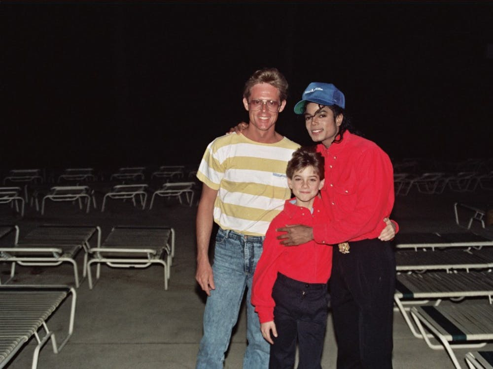 Michael Jackson with James Safechuck (center), who alleges a pattern of sexual abuse by the late singer.