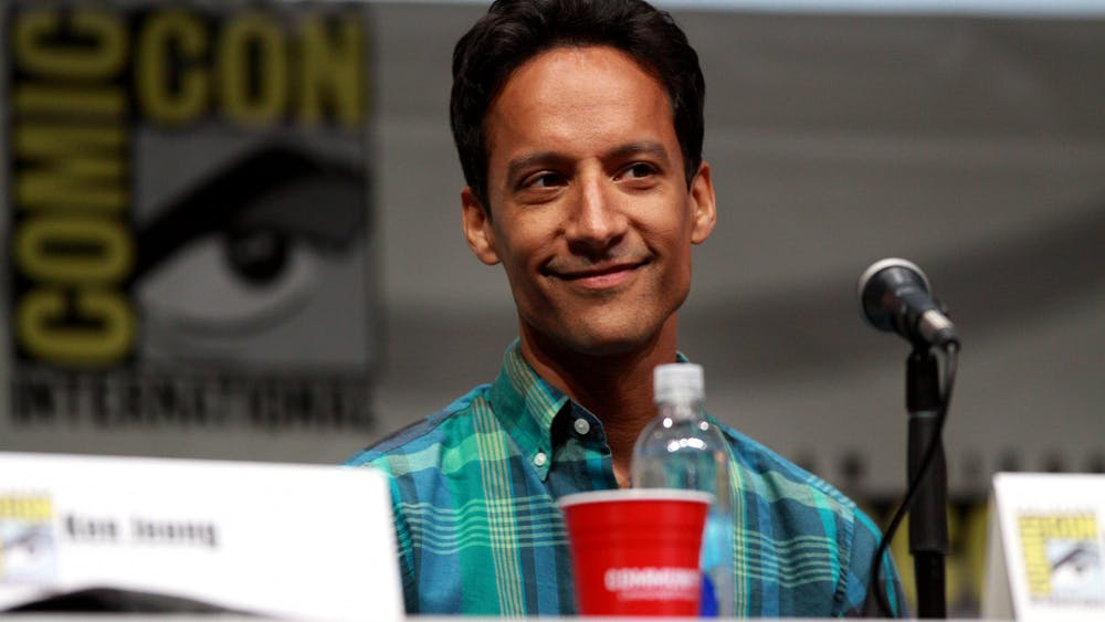 "Danny Pudi of ""Community"" speaks at San Diego Comic Con in 2013."
