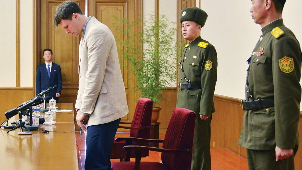 "Otto Frederick Warmbier (3rd R), a University of Virginia student who has been detained in North Korea since early January, attends a news conference in Pyongyang, North Korea, in this photo released by Kyodo February 29, 2016. Warmbier was detained for trying to steal a propaganda slogan from his Pyongyang hotel and has confessed to ""severe crimes"" against the state, the North's official media said on Monday. Warmbier, 21, was detained before boarding his flight to China over an unspecified incident at his hotel, his tour agency told Reuters in January. Mandatory credit REUTERS/Kyodo ATTENTION EDITORS - FOR EDITORIAL USE ONLY. NOT FOR SALE FOR MARKETING OR ADVERTISING CAMPAIGNS. THIS IMAGE HAS BEEN SUPPLIED BY A THIRD PARTY. IT IS DISTRIBUTED, EXACTLY AS RECEIVED BY REUTERS, AS A SERVICE TO CLIENTS. MANDATORY CREDIT. JAPAN OUT. NO COMMERCIAL OR EDITORIAL SALES IN JAPAN. - RTS8H5V"