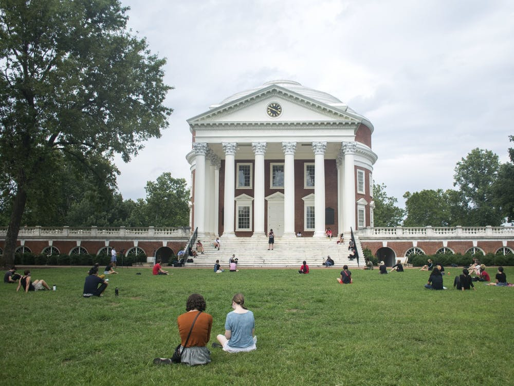 """A """"Die-In"""" demonstration was held on the Lawn Wednesday to protest the University's decision to proceed with in-person classes, which are scheduled to begin Tuesday."""