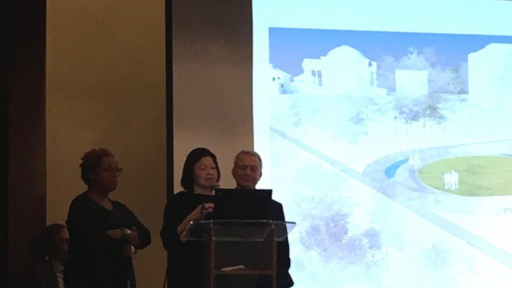 The focus of the meeting was on twoproposed design plans for the Memorial for Enslaved Laborers at the University.