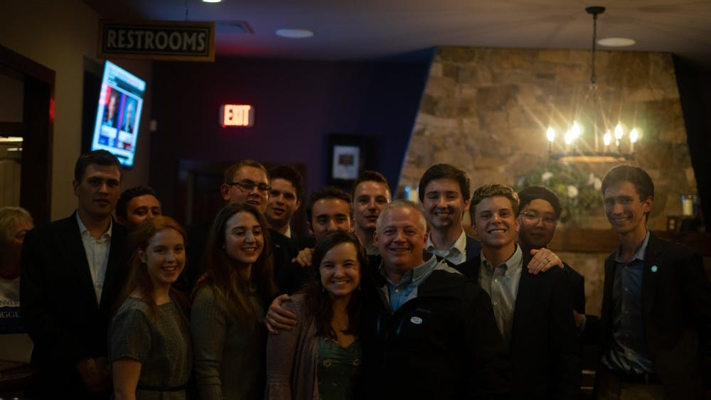 Republican Denver Riggleman, who was elected to represent Virginia's Fifth Congressional District Tuesday night, poses for a photo with members of the College Republicans at his election party.