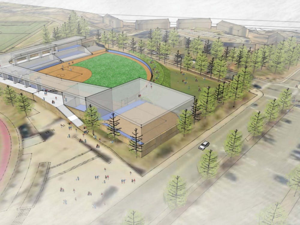 The new softball stadium would replace a grass soccer and lacrosse practice field on Massie Road and Copeley Road.