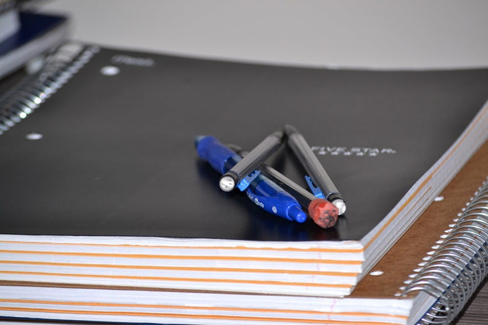 li-notebooksandpens-isalken