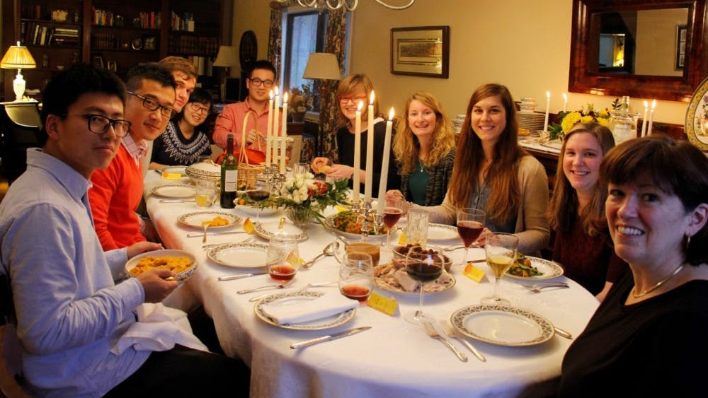 Prof. Dorothy Kelly hosting a Thanksgiving dinner as part of the Meal Match program in 2015.