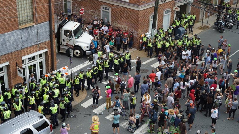 There was tension between protesters and police Sunday at the intersection of Fourth Street and Water Street Sunday afternoon. This was the site of last year's car attack near the Downtown Mall.