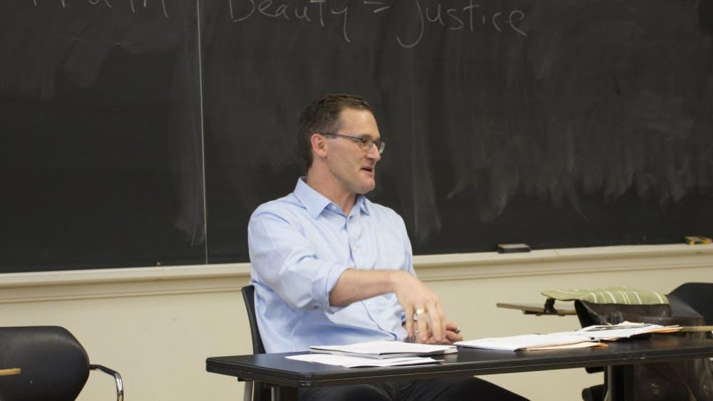 Charlottesville Mayor Mike Signer teaching his graduate-level politics class at the University of Virginia.