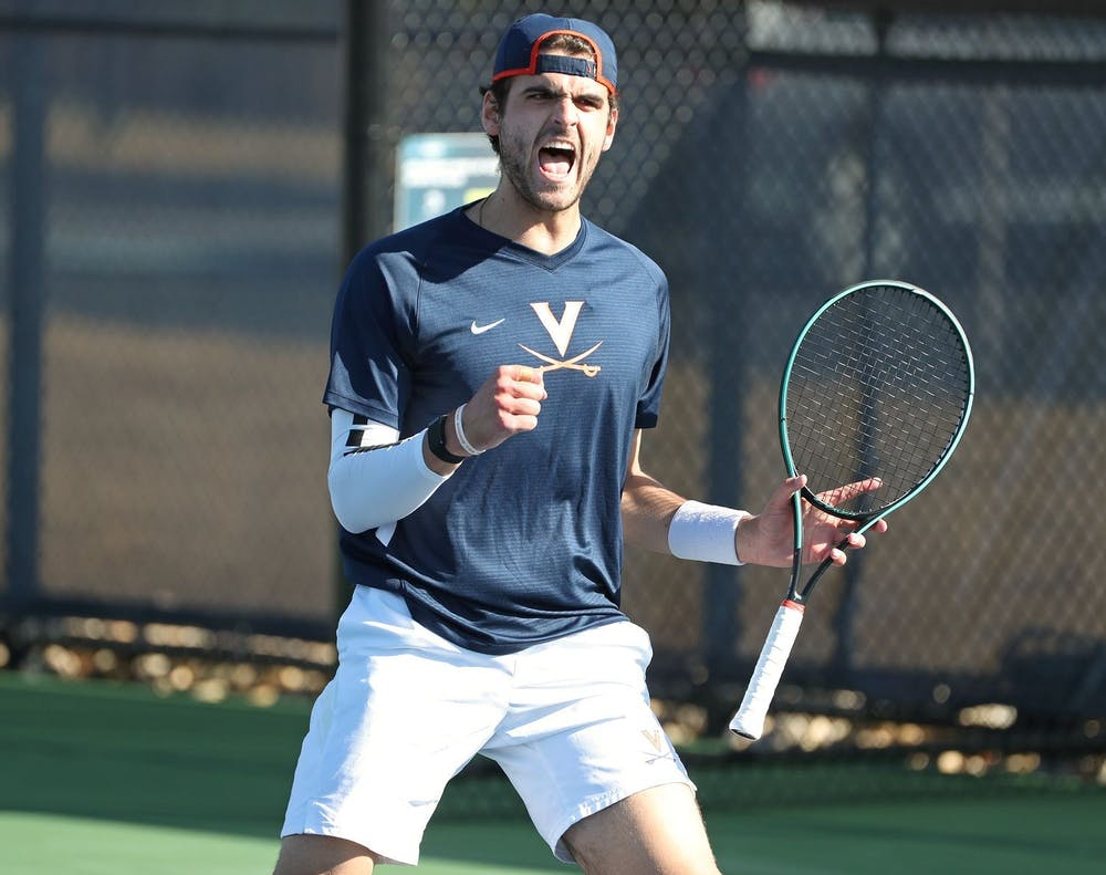 <p>Virginia junior William Woodall teamed up with senior Carl Söderlund to earn a doubles point for the Cavaliers</p>