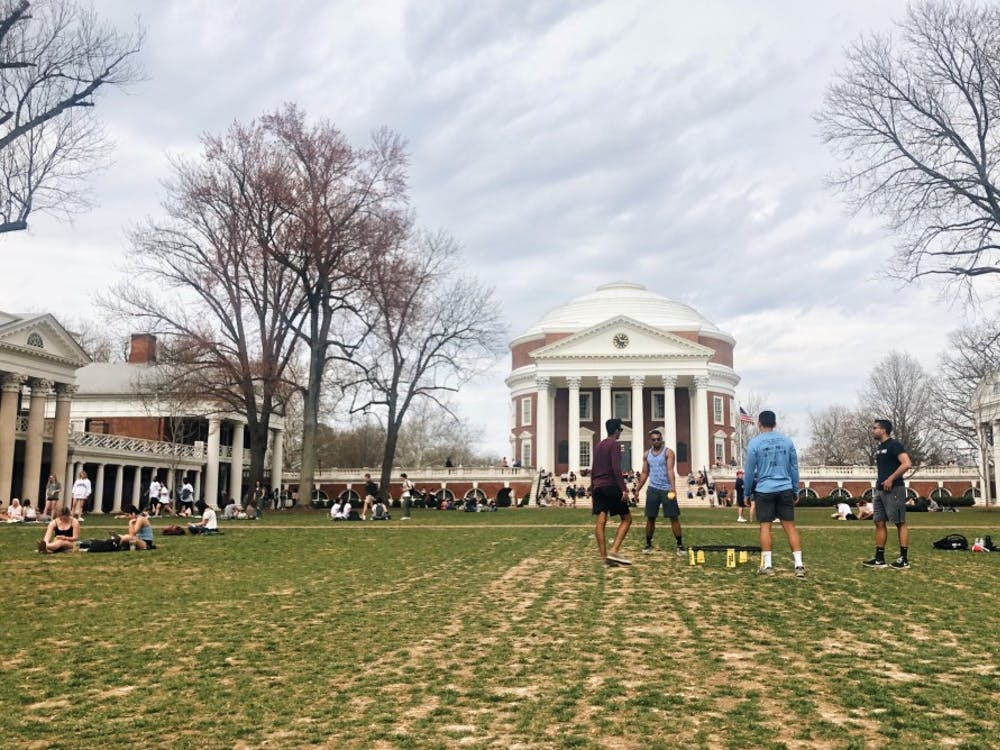 Students play spikeball on the Lawn on a spring afternoon.