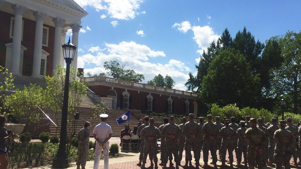 In addition to Khan's parents, his brothers Omer and Shaharyar, classmates from his ROTC class and cadets from the Army ROTC program at the University attended the ceremony.