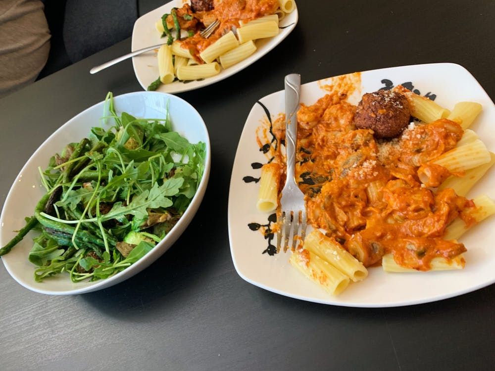<p>A colorful spread of greens and Gigi Hadid's famous vodka pasta create a feast for both your eyes and your stomach.</p>