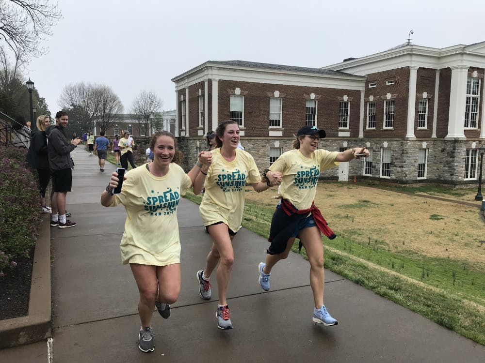 <p>Fourth years in Pi Beta Phi, Lindsay Klein, Talley Snow and Augusta Durham, joyously cross the finish line.</p>